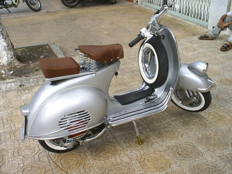 Vintage vespa scooter club austin